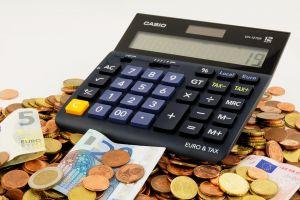 calculator on a mountain of money