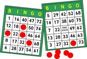 Bingo cards with numbers on it. There is a red chip on some numbers.