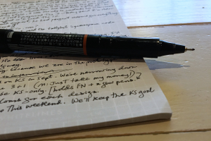 pen on a described sheet of paper