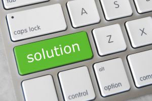 One-key keyboard with the words SOLUTION