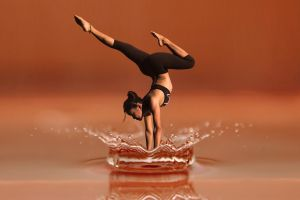 Woman in handstand in water