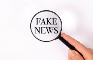 loupe that zooms in on 'Fake news'