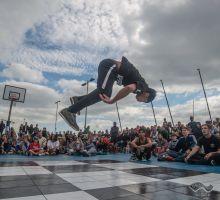 street dance, man dances, audience watches