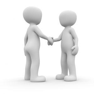 2 figures that shake hands