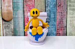 Yellow doll is on the toilet