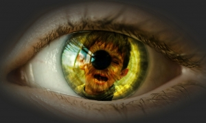 eye with reflection of a weeping boy