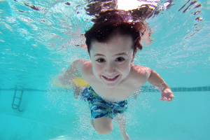 child swimming under water