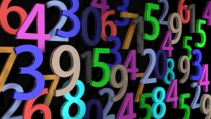 Colored numbers on a black background