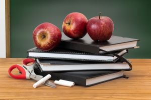 pile of books and apples