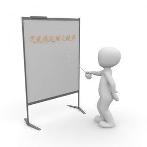 teacher in front of a blackboard