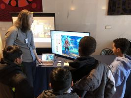 teacher and children at screen with Classcraft on
