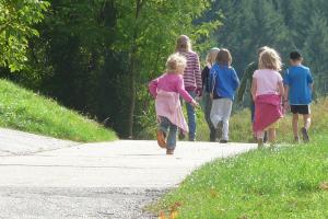 children walk on a path