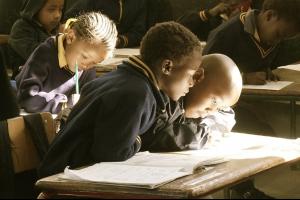 school children work on their desk